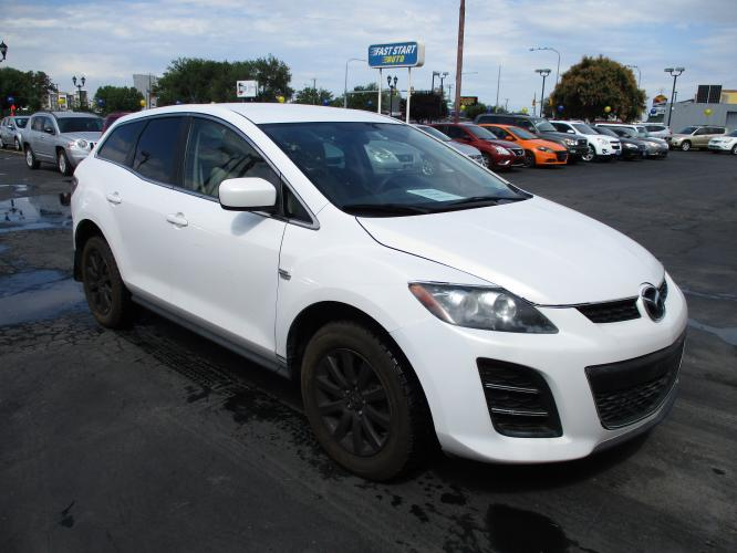 2011 White MAZDA CX-7 (JM3ER2A54B0) with an 4-Cyl 2.5 Liter engine, Automatic, 5-Spd w/Overdrive and SportShift transmission, located at 344 Washington Road, Ogden, UT, 84404, (801) 399-1799, 41.257221, -111.969597 - Photo #0