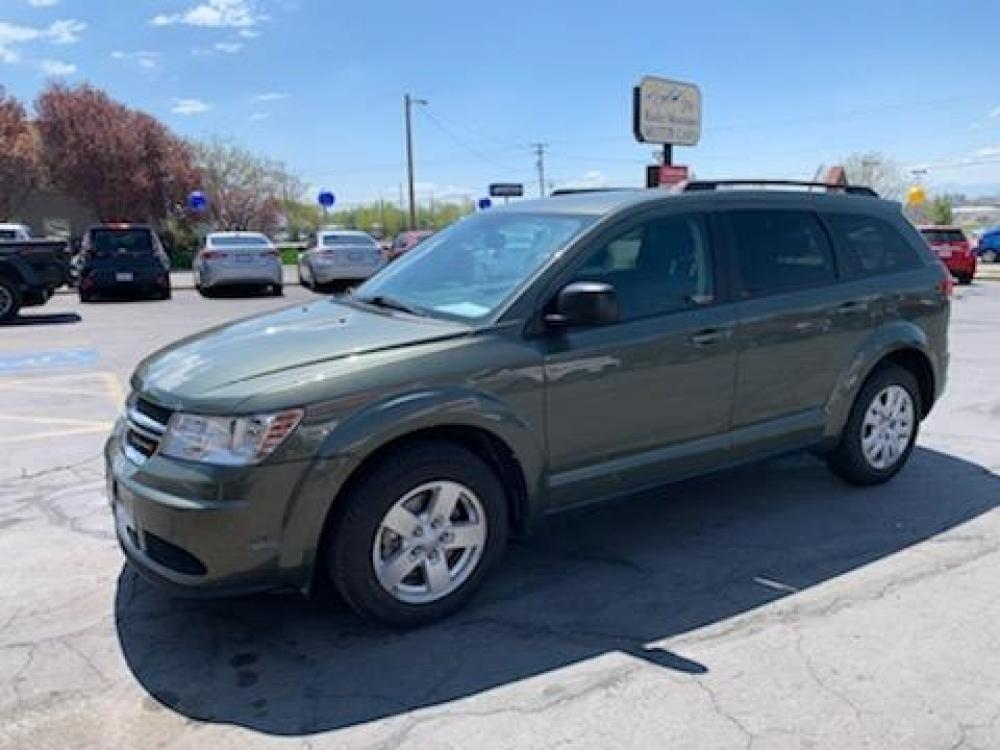 2016 Green Dodge Journey (3C4PDCAB9GT) with an 4-Cyl 2.4 Liter engine, Auto, 4-Spd AutoStick transmission, located at 767 S State Road, Pleasant Grove, UT, 84062, (801) 785-1058, 40.352489, -111.732628 - Photo #0