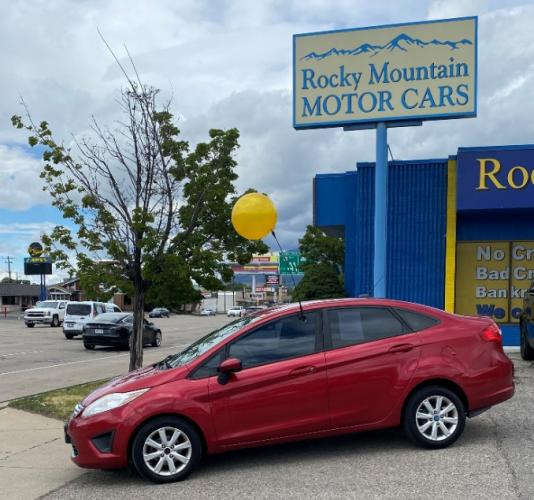 2011 Red Ford Fiesta (3FADP4BJ7BM) with an 4-Cyl 1.6 Liter engine, Automatic, 6-Spd w/Overdrive transmission, located at 344 Washington Road, Ogden, UT, 84404, (801) 399-1799, 41.257221, -111.969597 - Photo #0